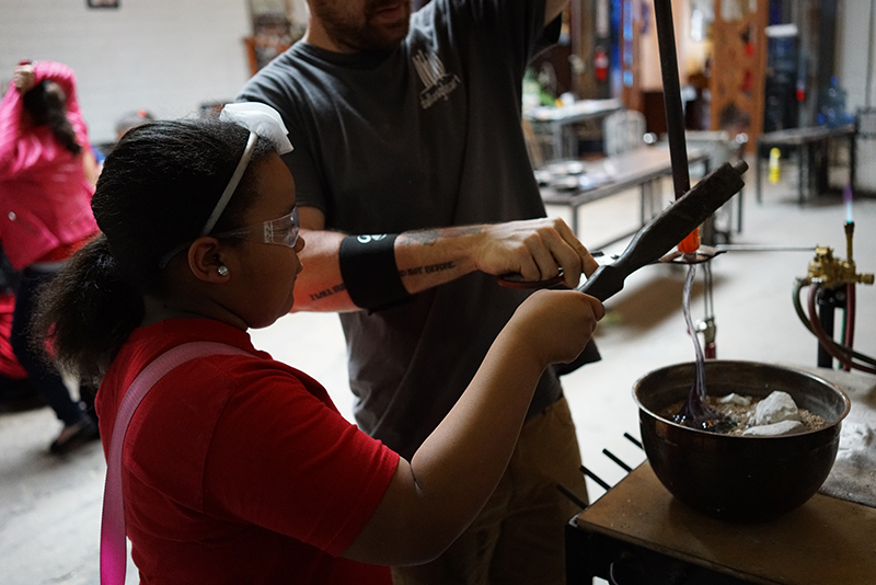 Bonking off the flower they just made to be fire polished and cooled properly in the annealer
